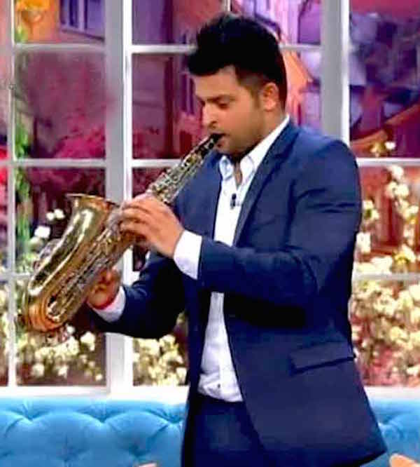 Suresh Raina playing saxophone