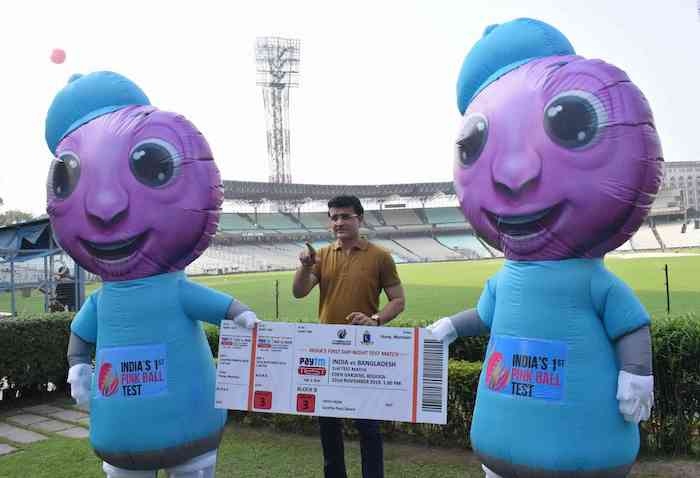 BCCI president Sourav Ganguly displays a blown-up ticket alongside the mascots for the match
